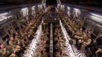 British military personnel in southern Afghanistan sit patiently onboard a RAF C17 destined for the UK.
