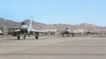 RAF Typhoon FGR4 multi-role fighter taxy in a line at Nellis Air Force Base, Nevada where 1(F) Sqn are training on Ex Red Flag.