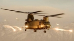 A Royal Air Force Chinook helicopter firing flares over Afghanistan.